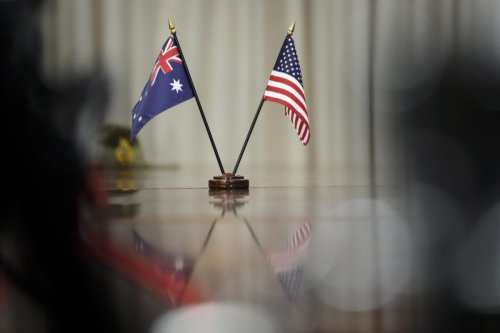 Australian and American flags sit on the table during a meeting between Prime Minister of Australia Scott Morrison and U.S. Secretary of Defense Lloyd Austin at the Pentagon on September 22, 2021 in Arlington, Virginia [Drew Angerer/Getty Images]