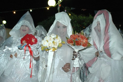 Libyan brides in traditional marriage outfits in Tripoli, late 05 September 2006 [MAHMUD TURKIA/AFP via Getty Images]