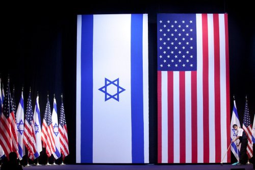 Israeli and US flags are seen in Jerusalem on 21 March 2019 [Uriel Sinai/Getty Images]