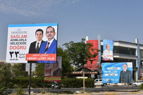 Posters of parties and candidates participating in the early general election race in Kirkuk, Iraq on 2 October 2021 [Ali Makram Ghareeb/Anadolu Agency]
