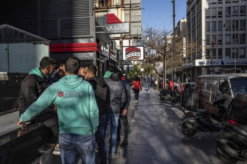 Food delivery couriers for Toters on Hamra street in Beirut, Lebanon on 14 April 2021 [Francesca Volpi/Bloomberg/Getty Images]