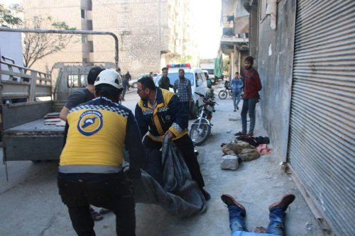 A rescue team from the White Helmets after an attack in the town of Ariha, southern Idlib, Syria, on 20 October 2021