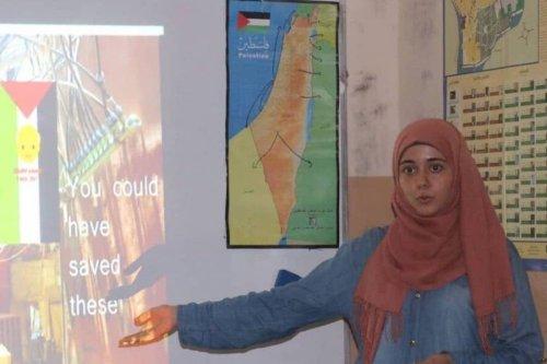 Aya Youssef explaining an electricity problem at Burj Al-Barajneh Refugee Camp in Lebanon [Aya Yousef]