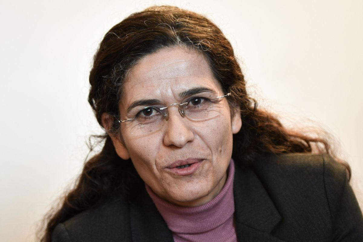 One of the two top political leaders of the Syrian Kurdish alliance and co-chair of the Syrian Democratic Council Ilham Ahmed delivers a speech during a press-conference, in Paris, on 21 December 2018. [STEPHANE DE SAKUTIN/AFP via Getty Images]