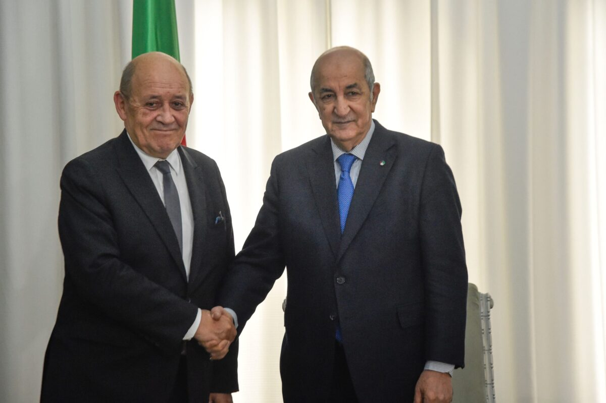 Algerian President Abdelmadjid Tebboune (R) meets with the visiting French Foreign Minister Jean-Yves Le Drian in the capital Algiers on January 21, 2020 [RYAD KRAMDI/AFP via Getty Images]