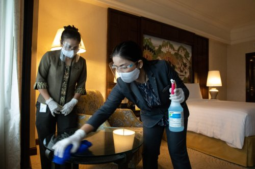 Thai housekeepers on Octerber 8, 2020 [Taylor Weidman/Bloomberg via Getty Images]