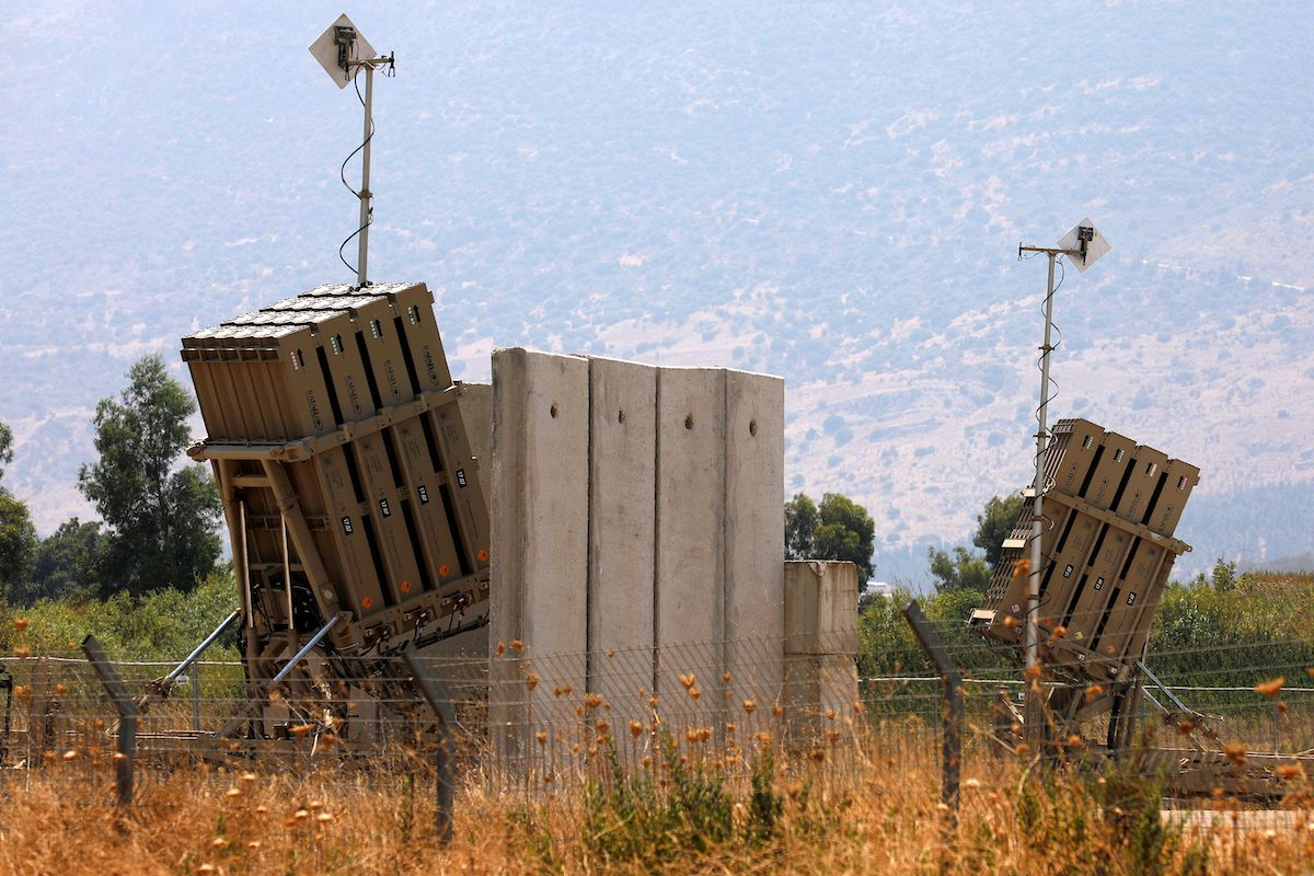 A picture taken on August 5, 2021, shows an Iron Dome defense system battery, designed to intercept and destroy incoming short-range rockets and artillery shells, in the Hula Valley in northern Israel near the border with Lebanon. [JALAA MAREY/AFP via Getty Images]