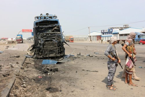 Fighters from the separatist Southern Transitional Council gather at the site of a reported car bomb, that targeted the head of local police, in the town of Dar Saad in Yemen's Aden province on August 14, 2021 [SALEH AL-OBEIDI/AFP via Getty Images]