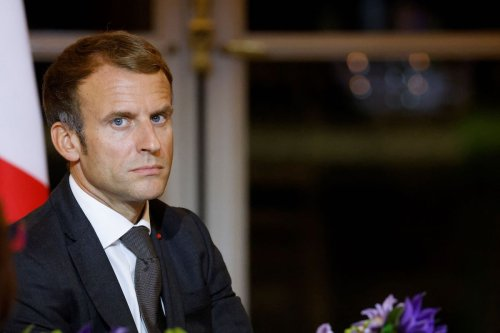 French President Emmanuel Macron reacts as he hosts a dinner at the Elysee Palace, on 30 September 2021 as part of the closing ceremony of the Africa2020 season, which presented the views of the civil society from the African continent and its recent diaspora in different sectors of activity. [LUDOVIC MARIN/POOL/AFP via Getty Images]
