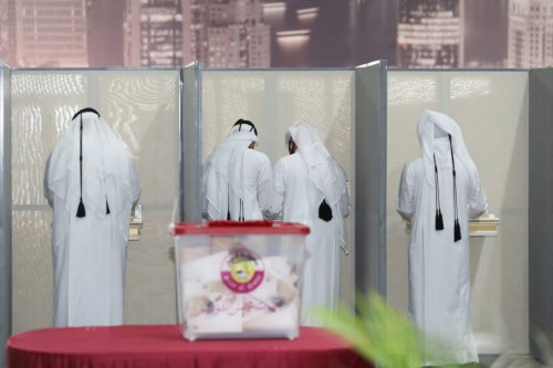 Qataris are pictured at a polling station during the country's first ever legislative elections, on October 2, 2021 [DENOUR/AFP via Getty Images]