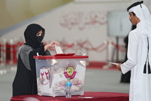 A Qatari woman casts her ballot at a polling station during the country's first ever legislative elections, on October 2, 2021 [DENOUR/AFP via Getty Images]