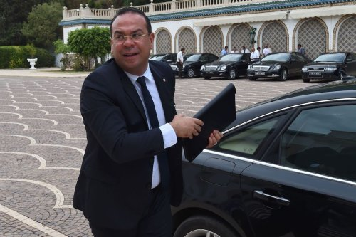 Tunisian Minister of Civil Society and Human Rights Mehdi Ben Gharbia arrives for the first cabinet meeting on 31 August 2016 at the Carthage Palace near Tunis. [FETHI BELAID/AFP via Getty Images]