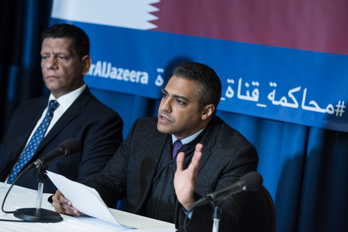 Mohamed Fawzi (L), former Al Jazeera English cameraman, listens while Mohamed Fahmy, former Al Jazeera English reporter, speaks during a press conference at the National Press Club about a lawsuit against Qatar's Al Jazeera 22 June 2017 in Washington, [BRENDAN SMIALOWSKI/AFP via Getty Images]