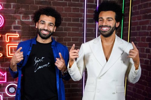 Liverpool's Mohamed Salah stands next to his waxwork at Madame Tussauds, London, UK on 21 October 2021 [MadameTussauds/Twitter