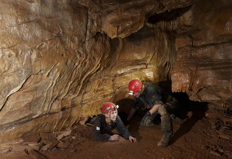 cavers in the Adventure Caves, Cheddar Gorge, Somerset, England, UK