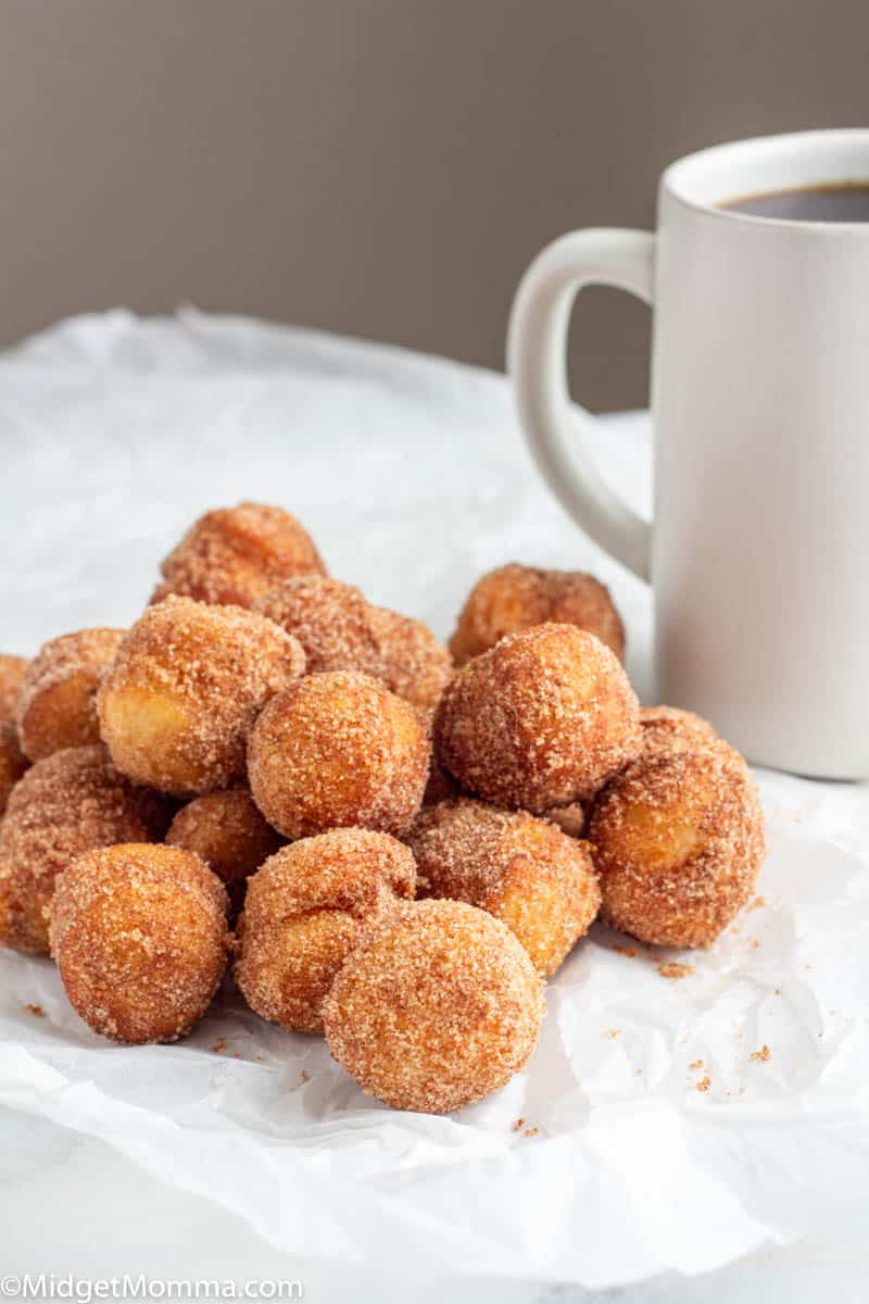Cinnamon Sugar Donuts on a plate with a cup of coffee