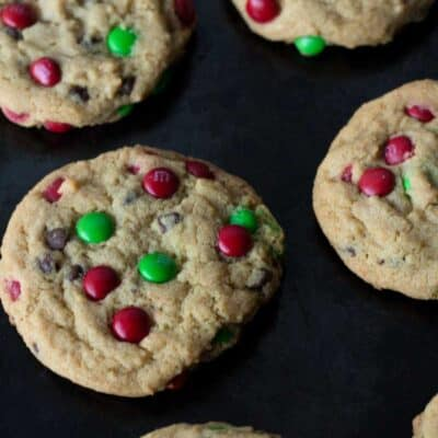 This cookie recipe is great because you get a taste of chocolate in every single bite. You can change up the color of m&m's to match any holiday. #Christmas #M&MCookie #ChocolateChip #Cookie #SoftCookie #ChewyCookie