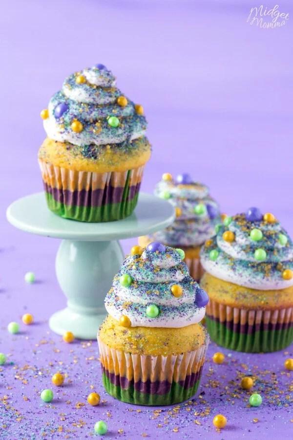 Homemade Mardi gras cupcakes on a cake stand