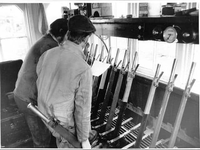 Fitting the interlocking in the ex Ais Gill Signal Box at Butterley. Sept 1986