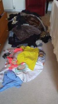 A pile of clothes to sort through before packing