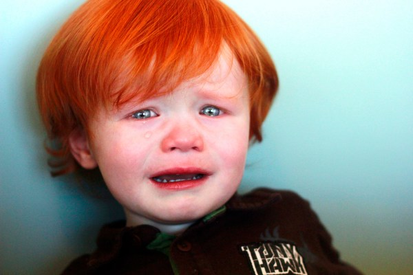 Small boy with bright red hair, crying
