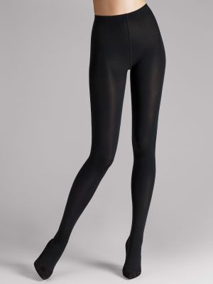 The legs of a model wearing black opaque tights