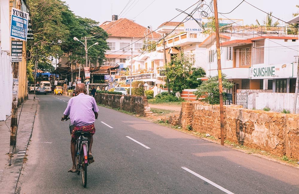 Man in purple shirt on a bicycle from behind - Great Indian Blog Train