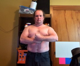 Week 2 of 15 WHG training. Shirtless, flexed. And looking fairly silly doing it.