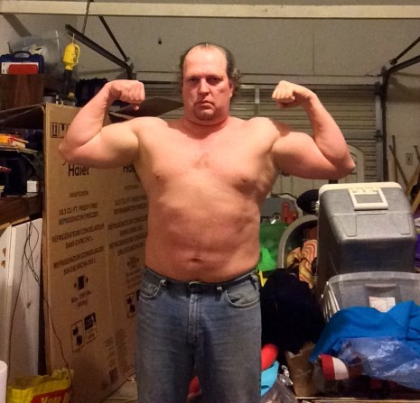 Week 3 of 15 WHG training. Shirtless, flexed. And looking fairly silly doing it.