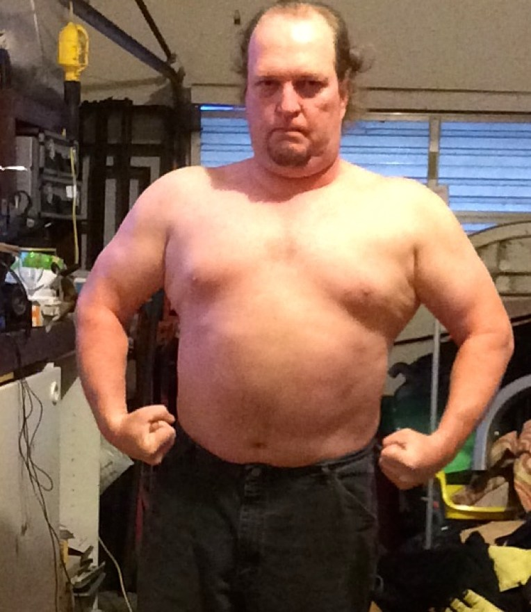 Week 4 of 15 WHG training. Shirtless, flexed. And looking fairly silly doing it.