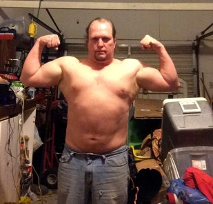 Week 5 of 15 WHG training. Shirtless, flexed. And looking fairly silly doing it.
