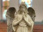 Praying angel statue