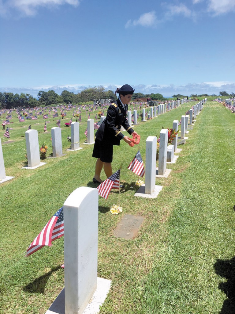 U. S. Rep. Gabbard, a major in the Hawaii Army National Guard, offers lei to fallen heroes at Makawao Veterans Cemetery before delivering keynote remarks at a Memorial Day Ceremony
