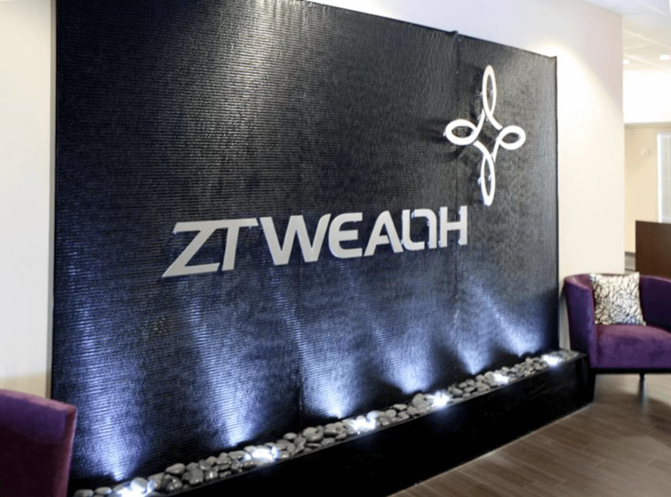 ZT Wealth Houston Texas   black acrylic water wall