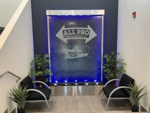 Glass Water Wall with Stainless Steel Frame and Etched Vinyl Logo