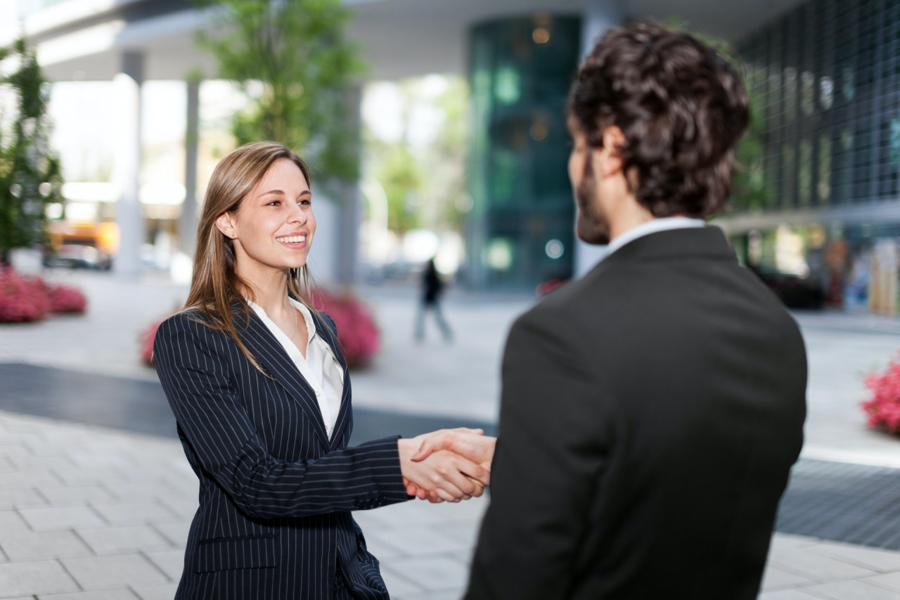 Businesswoman shaking a businessman's hand