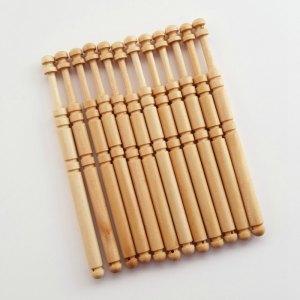 Set of 12 hardwood bobbins for lacemaking.