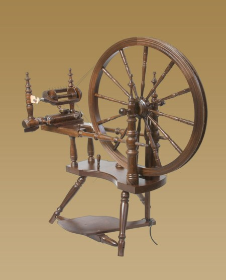 Polonaise spinning wheel with walnut finish.