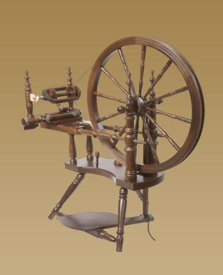 Polonaise spinning wheel with walnut finish.