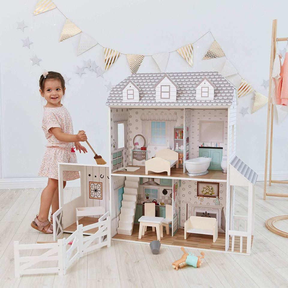 A girl with her doll house.
