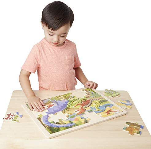 A boy doing a puzzle makes it to the best gift ideas for kids.
