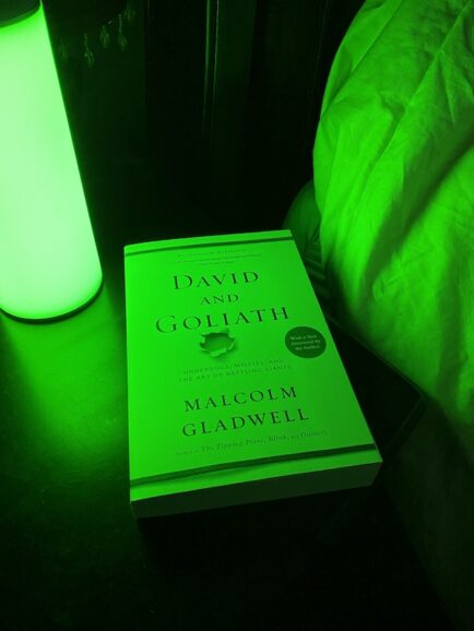 closed book with Allay Lamp for green light for migraine