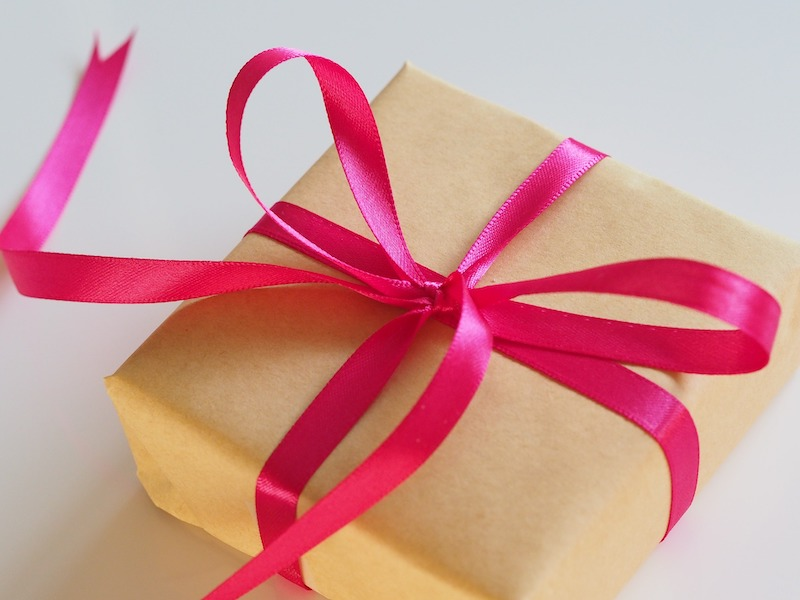 gold box with pink ribbon gift ideas for migraine