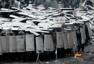 Protesters clash with police in Kiev on Jan. 22, 2014.