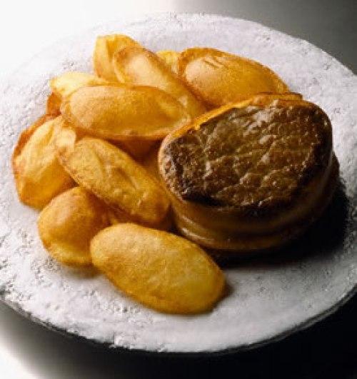 Solomillo con patatas infladas