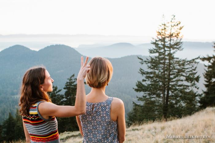Two young women watching sunset