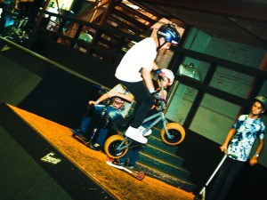 Kids showing their Rocker Mini BMX tricks in front of the Pros at Rush Skate Park
