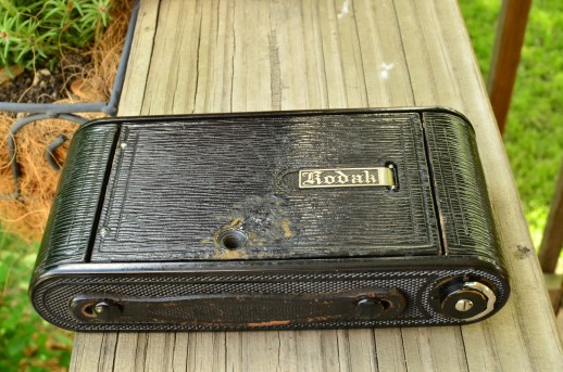 This camera obviously had been mounted to a tripod in the past, which is why the leather is damaged in that area.