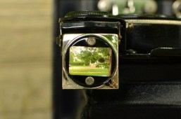 This is an example of what you see in the viewfinder. It can be rotated to a Horizontal or Vertical position. The large dark dot is desilvering of the mirror.