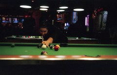 I am extremely pleased with this shot as it was done in a poorly lit bar. The lens is wide open, and I stabilized the camera on another pool table.